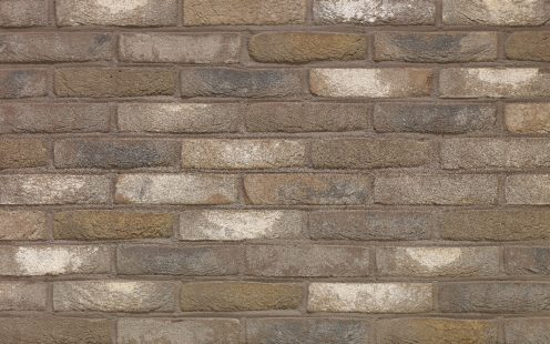 Arces Moon Grijs facing bricks in a traditional mortar application with a running bond and with the sale color joint as the color of the brick